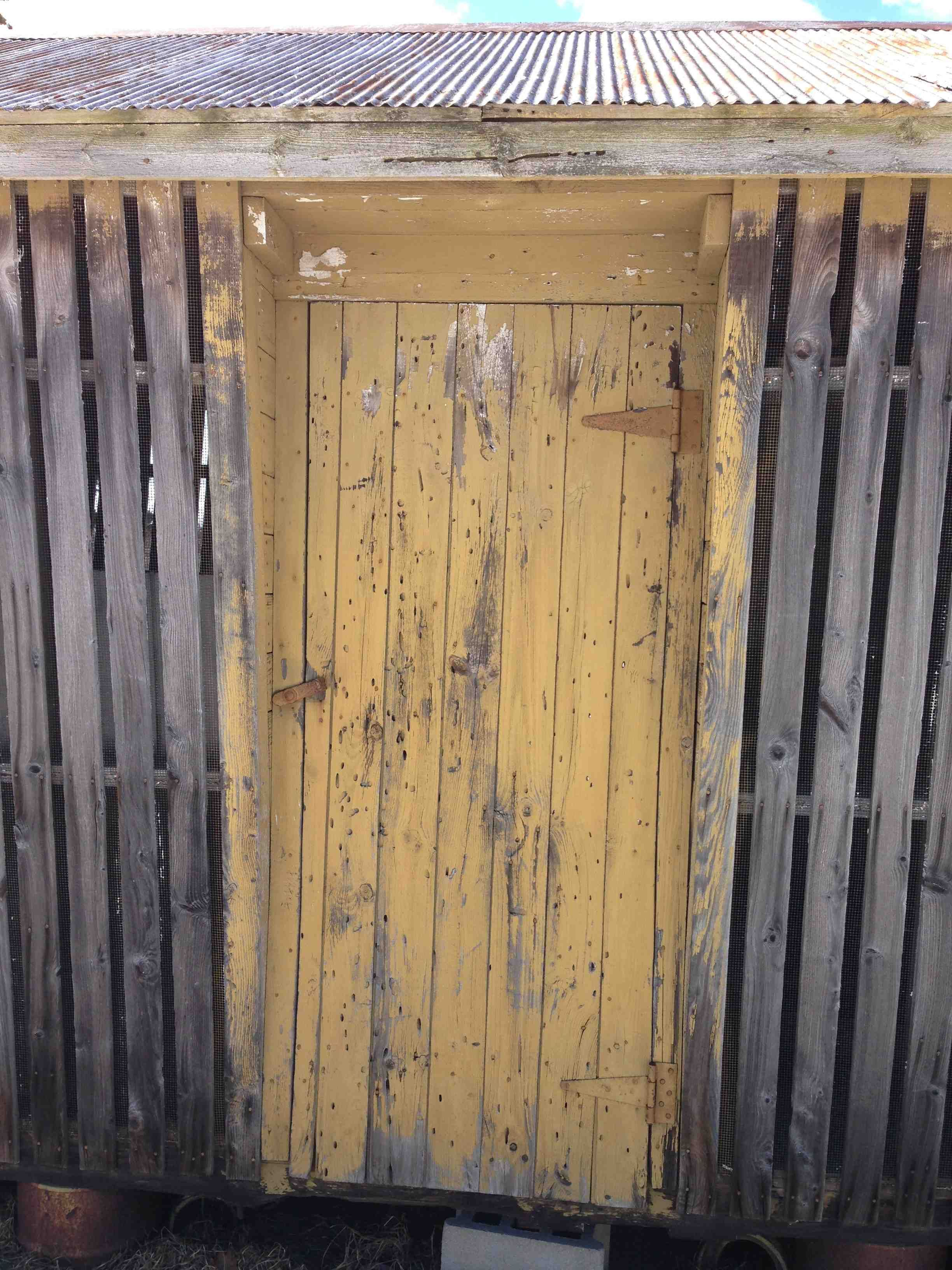 Front door to vintage corn crib - call us and we will help with the remodeling plans.