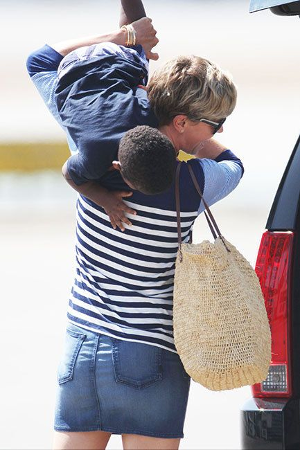 Charlize Theron has some fun with her son Jackson on the way to a flight in…
