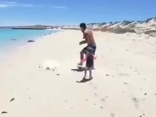His buddy waited for him in the water