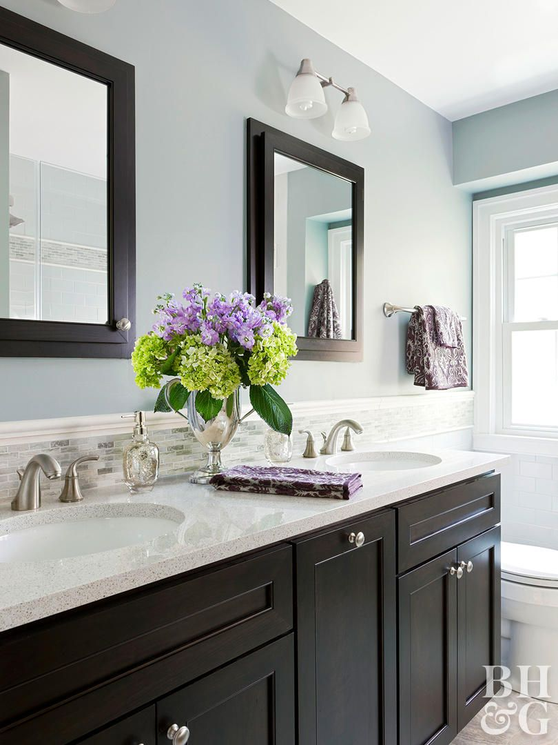This bathroom mixes muddied up shades of gray and blue with soft cream trim to achieve its soothing attitude