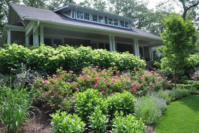 Sloped front yard landscaping and gardening solution for Front yard slope landscaping ideas