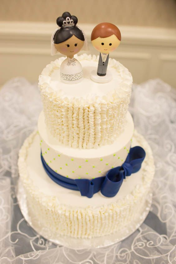 From the cake topper to the frilly icing, we just adore everything ...