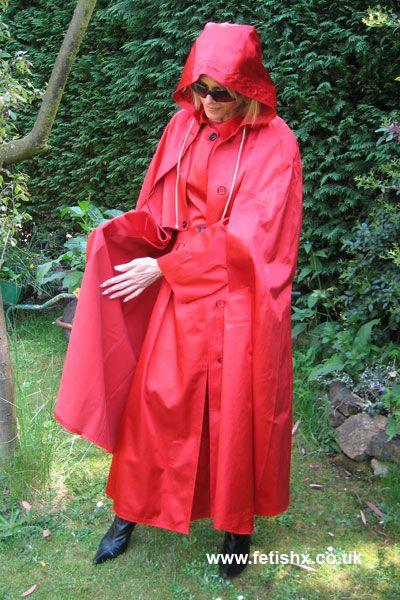 Hooded full flowing red mackintosh and cape. Magic!