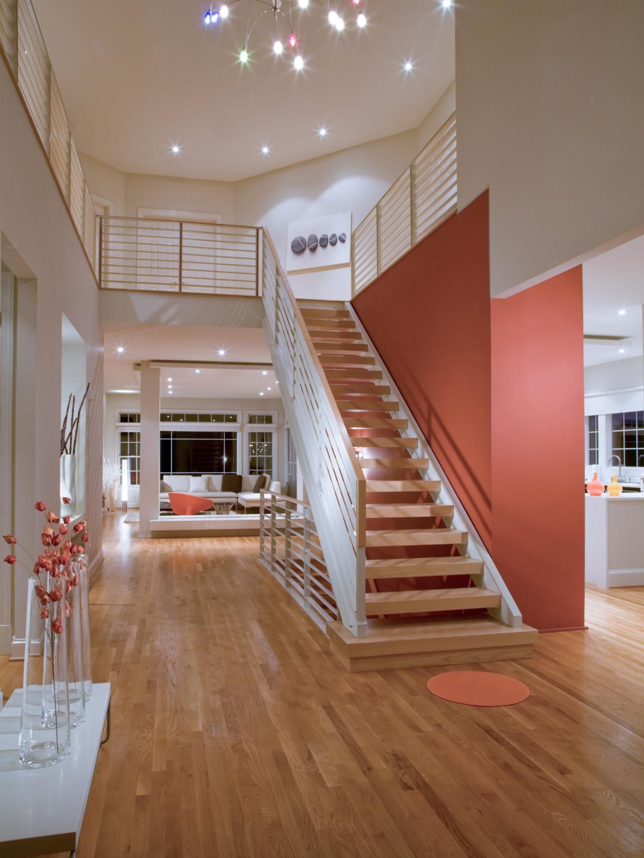 A Large Floating Staircase Helps To Break Up This Open