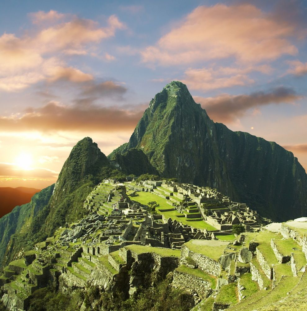 Many Have Described Machu Picchu As Sitting Like A Saddle Between Two Peaks Of The Andes Mountaintops Ga Top 10 Vacation Spots Wonders Of The World Picchu