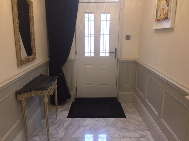 entrance hall with beaded wall panelling by wall panelling