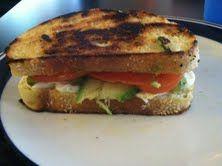 My lunch today: Sesame bakery bread, extra virgin olive oil, tomato, avocado, mozzarella, & feta. YUM :)