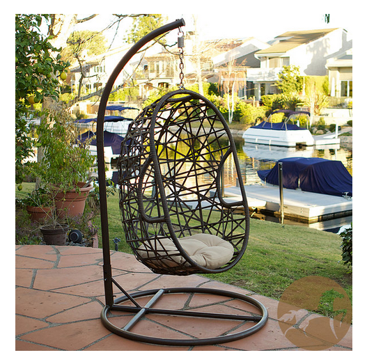 Swing Through Sunny Days In This Sturdy Outdoor Wicker