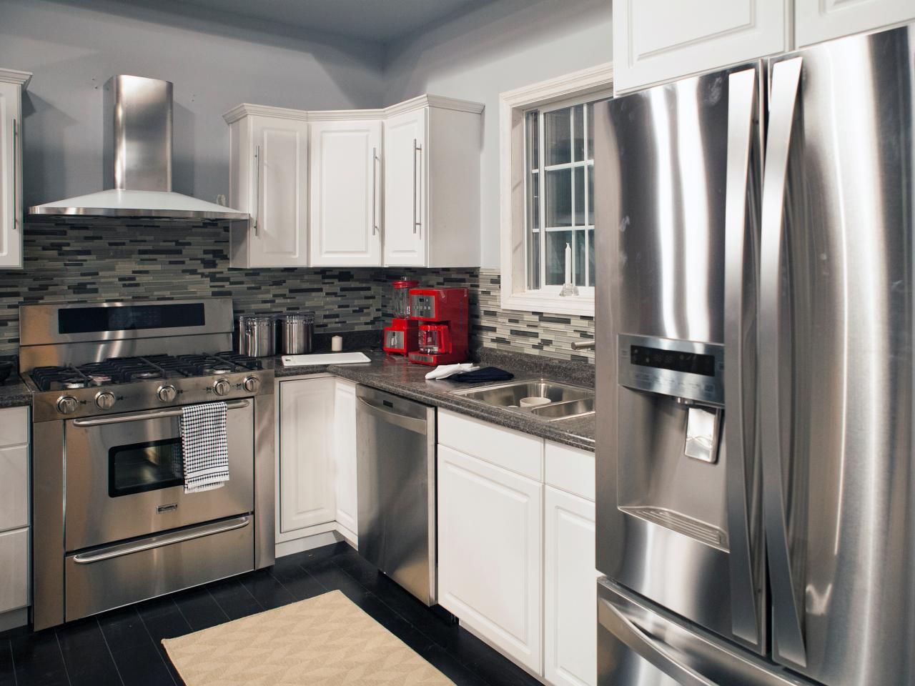 Stainless steel appliances dark gray countertops and a for Kitchen stainless steel cabinets