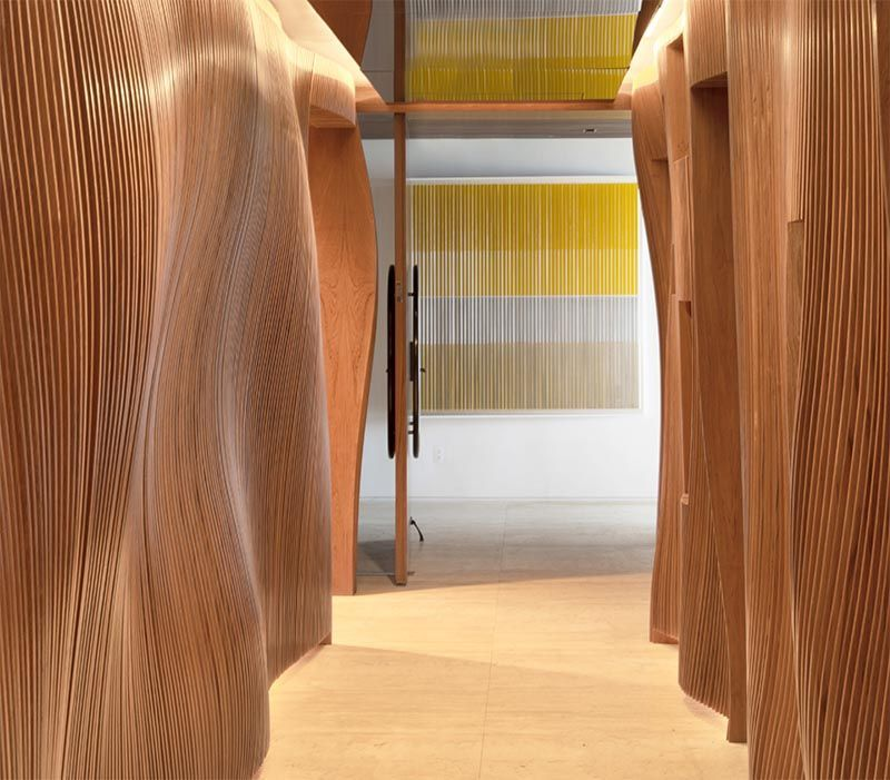 A Wavy Sculptural Hallway Greets Guests As They Arrive At This Apartment  Fernanda Marques Arquitetos Associados has designed an apartment in Miami Florida and as part of...