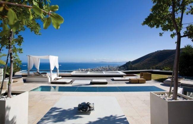 Niedrige Möbel terrasse niedrige möbel lounge himmelbett aussicht meer outdoor
