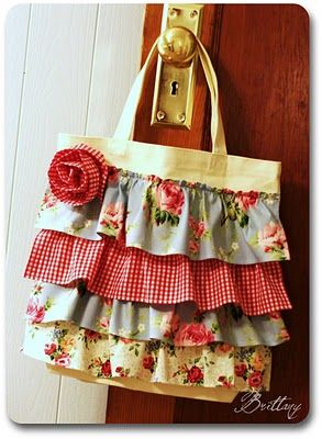 canvas tote bag with ruffles added to it.