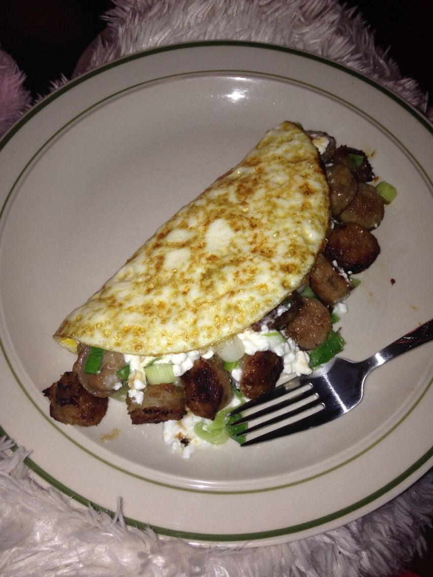 A chicken apple sausage omelette made with chives goat cheese and a