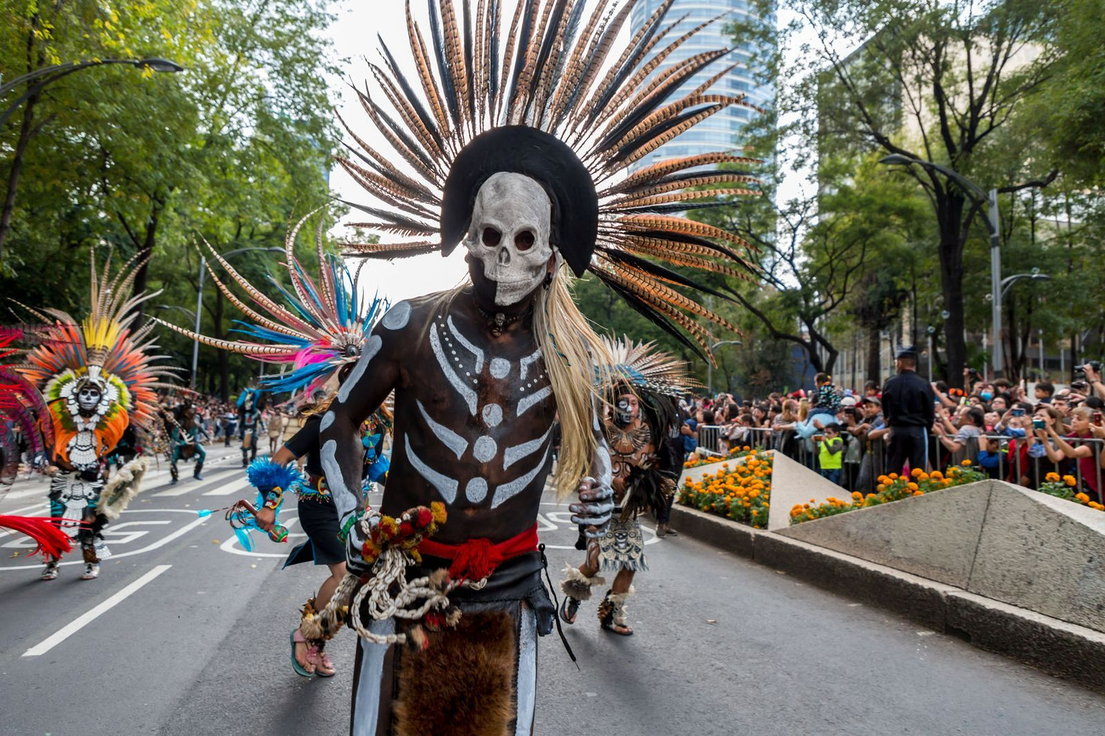 Skeletons Take Over The Streets Of Mexico City For Día De Los Muertos Aztec Art American Indian Tattoos Native American History