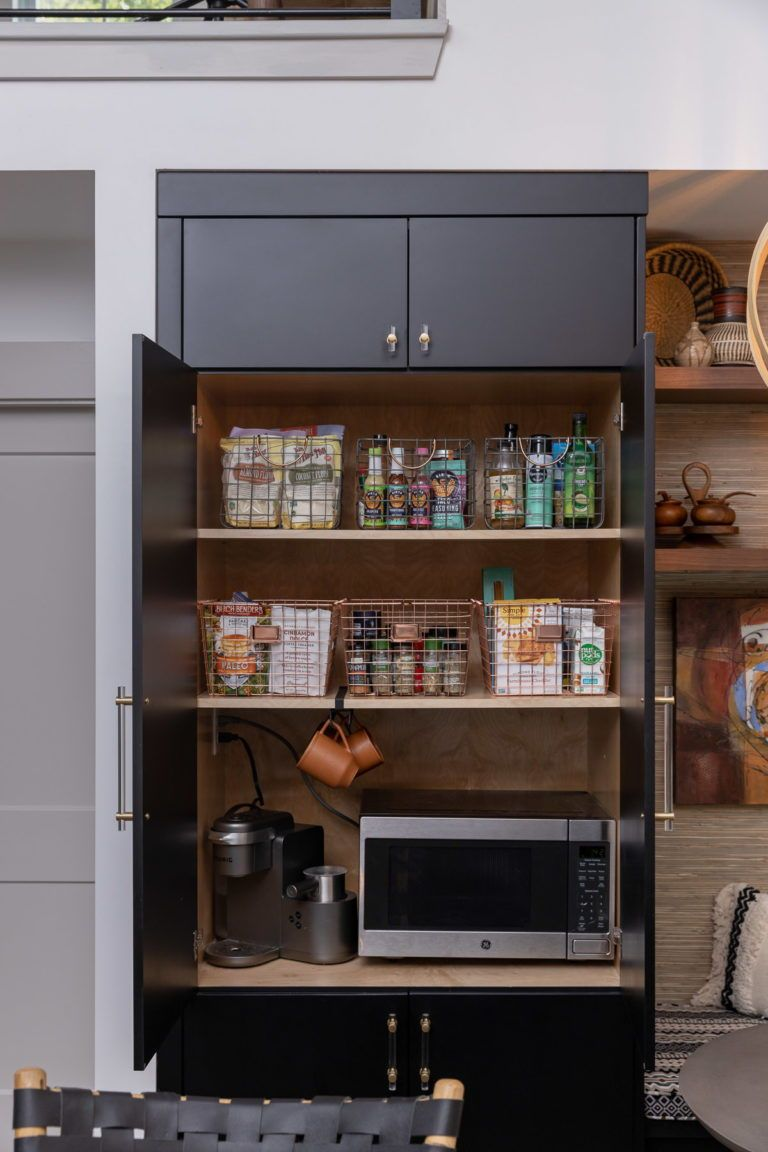 Easy to see and easy to reach! This tiny house pantry setup idea helps you make the most of your living space.    #tinyhouse #storage #pantry #crateideas #storageideas #cabinetstorage