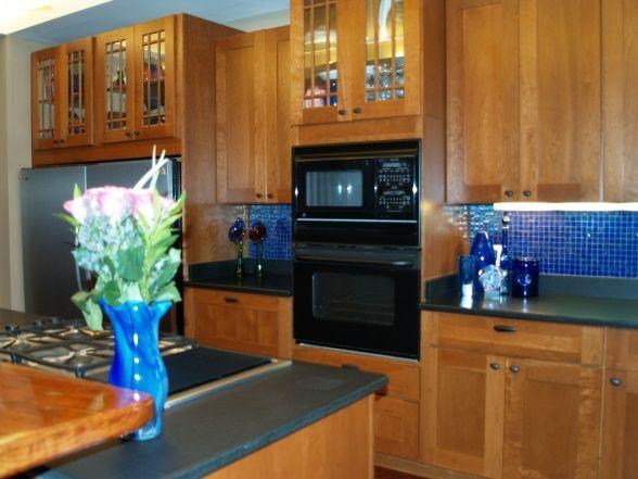 cobalt blue glass backsplash   honed black granite