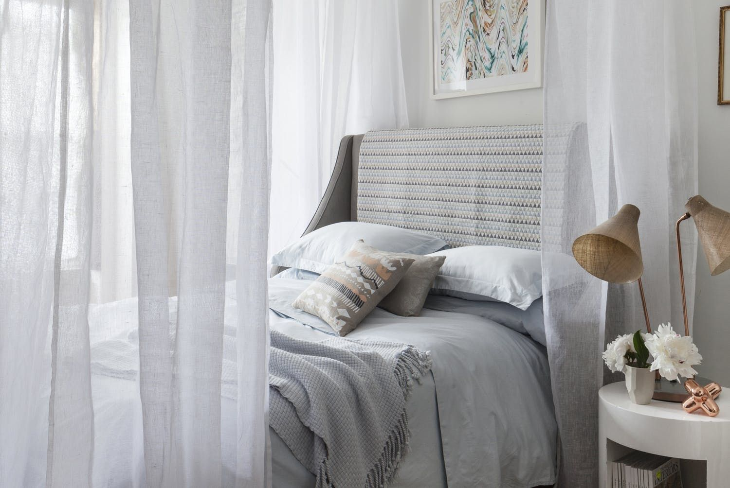 Bed against window with curtains  super stylish spacesaving diys every studio apartment needs