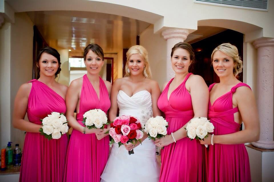 Beach wedding with two birds bridesmaids dresses in majenta pink ...