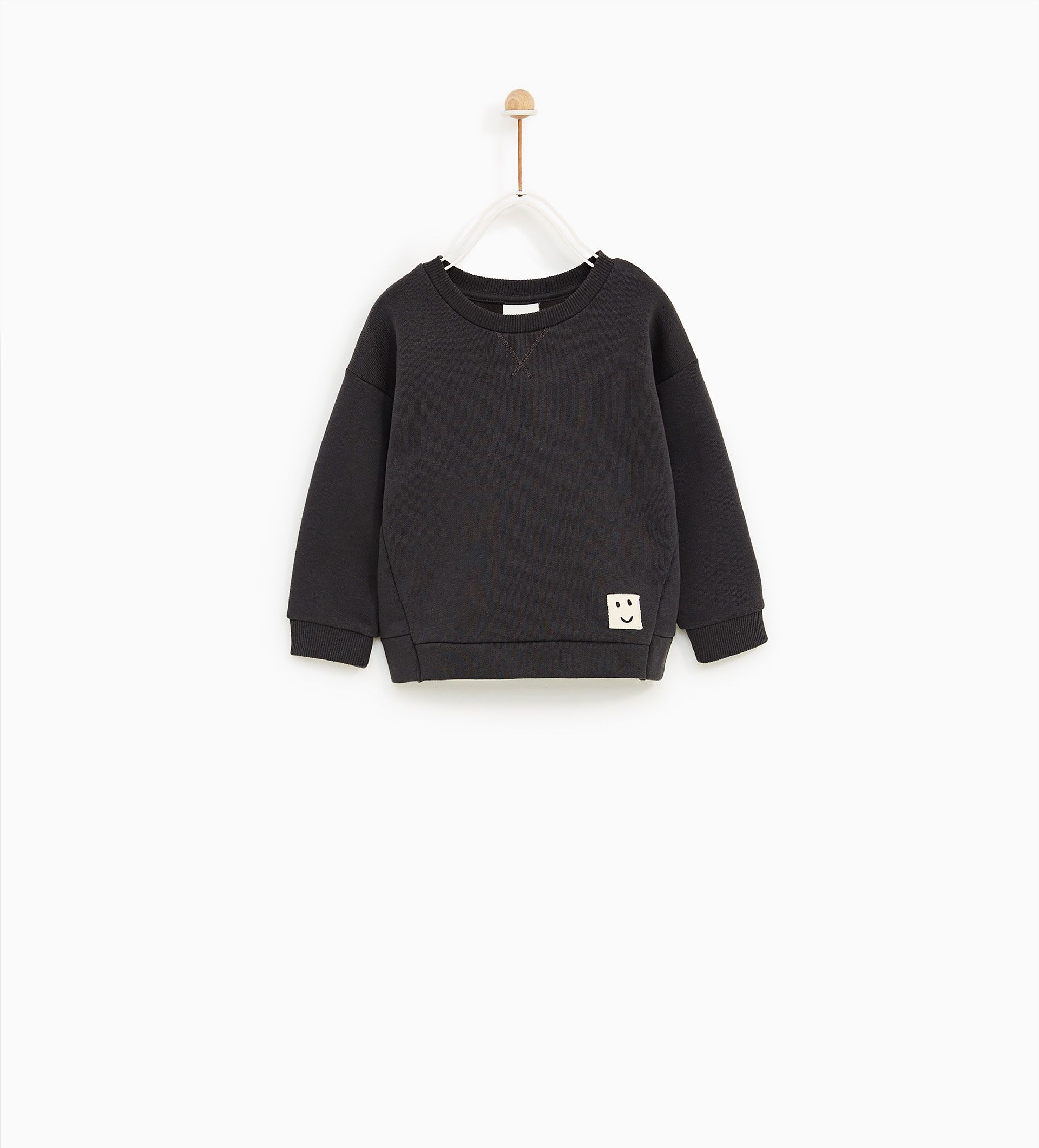 Image 1 Of Patterned Sweatshirt With Label Detail From Zara