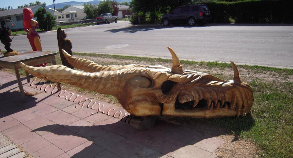 Dragon skull foot chainsaw carving carvings