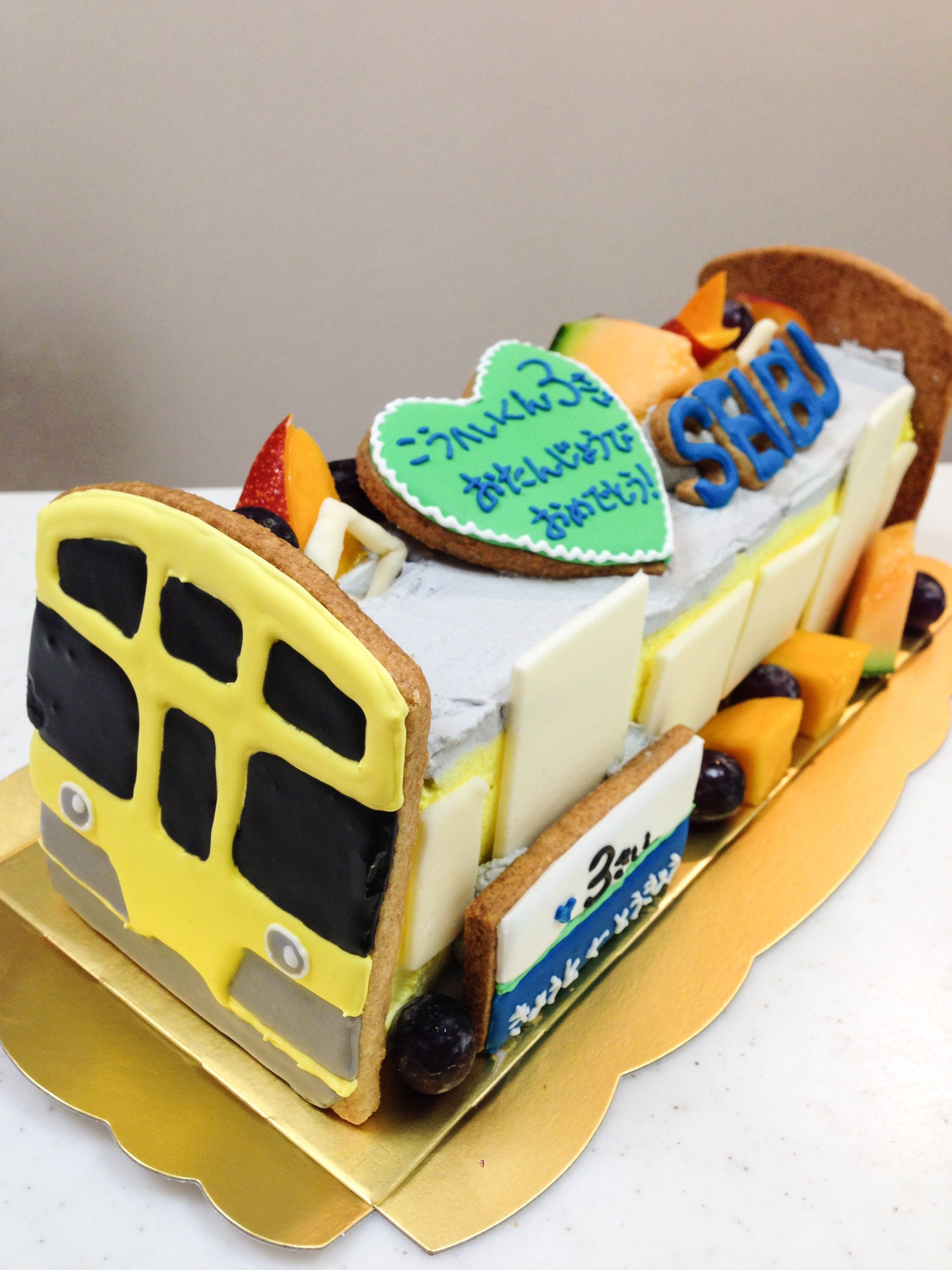 黄色い西武電車のケーキ その他のケーキ 電車 ケーキ、ケーキ、ディズニーケーキ