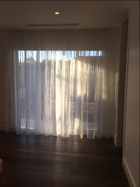 I like the practicality of roller blinds with a sheer curtain for ...