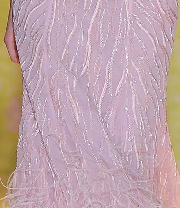 beautiful sequin and bead whispy lines into gradient ostrich feathers