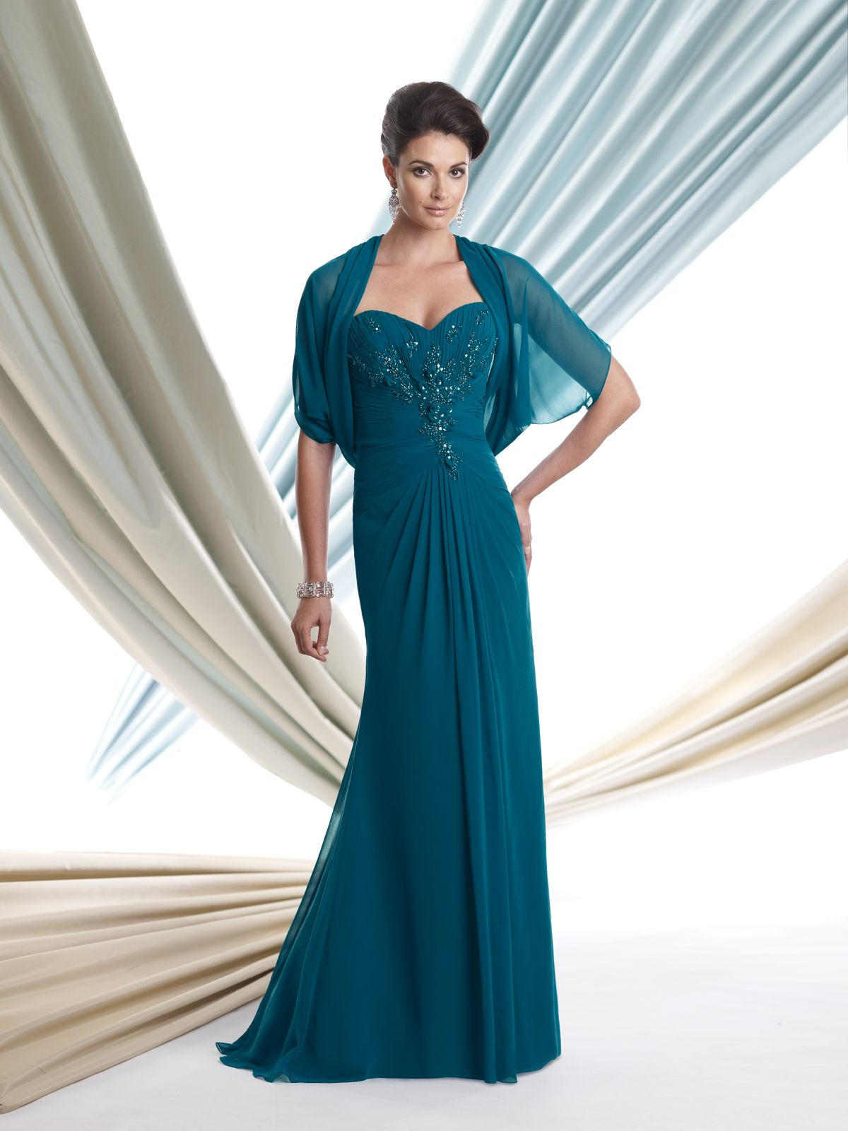 Two-piece silk chiffon dress set, strapless A-line dress with sweetheart neckline, directionally ruched bodice accented with hand-beaded motif, gathered inverted Basque waistline, matching shrug jacket. Removable straps included. Sizes:4 – 20, 16W – 26W