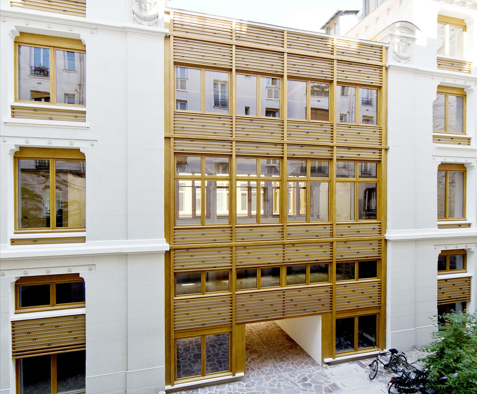 wooden office buildings. Parc Architectes Renovate A 19th-century Office Building In Paris With Beautiful Wooden Facade Buildings