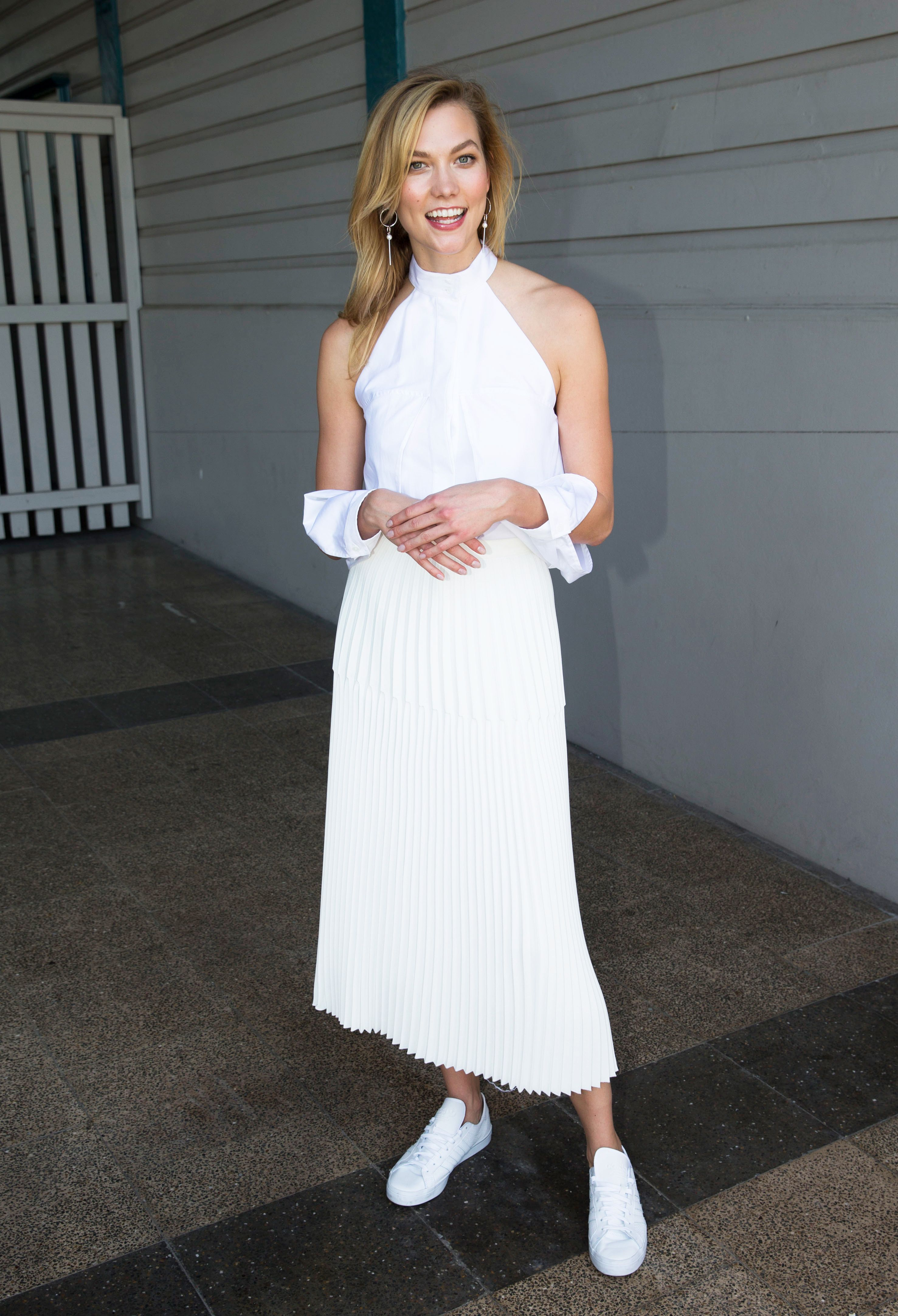 Karlie Kloss is the queen of making sneakers work with dressers. That plus one major shirt trend means you're going to want to see and shop this ASAP.