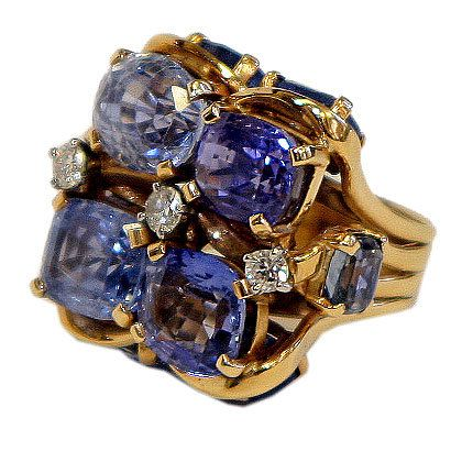 Unique design spectacular Retro ring by American designerSEAMAN SCHEPPS, 10 oval ceylon sapphires approximately 40 carats 3 diamonds 0.50 carats Circa 1940s