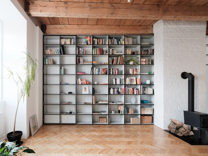 JRKVC Designed Clean And Functional Apartment Using Full Height Bookshelf As A Space Divider