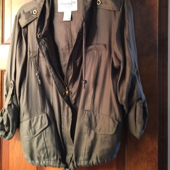American Rag green military style jacket army green military style jacket with full zipper and snaps. Roll up or down sleeves two front pockets and hooded American Rag Jackets & Coats
