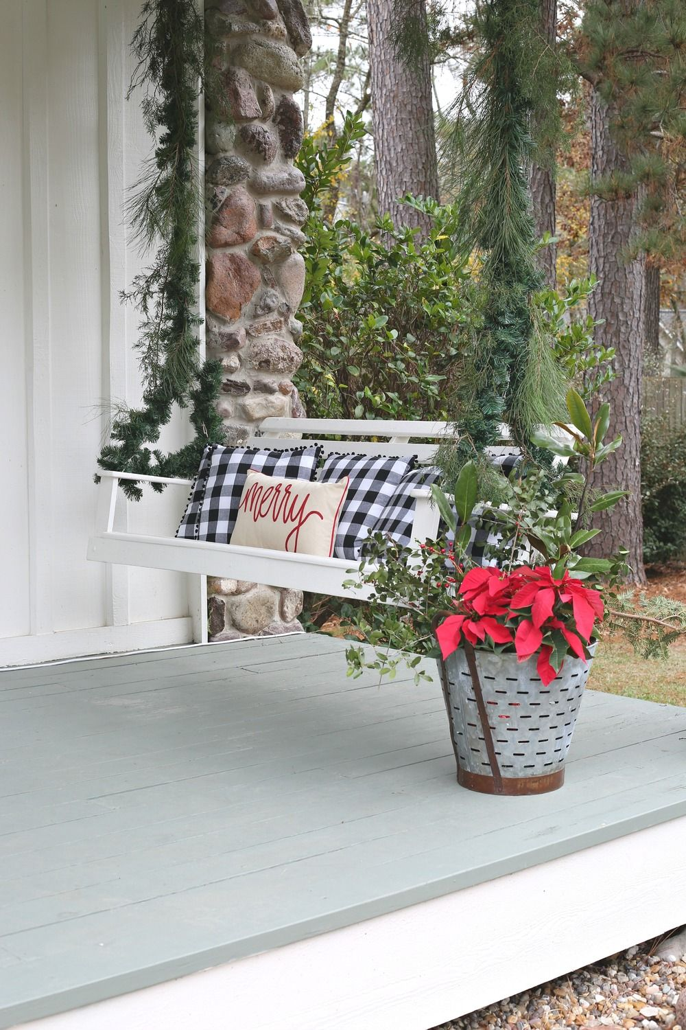 Christmas porch swing decorated with garland Front porch