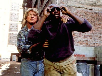 They Live 1988~WAY kool movie,seriously.Roddy Piper,Keith David are kickin' alien butt in this.Wish they had made a sequel.