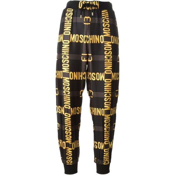Moschino All-Over Logo Print Trousers ($279) ❤ liked on Polyvore featuring  pants