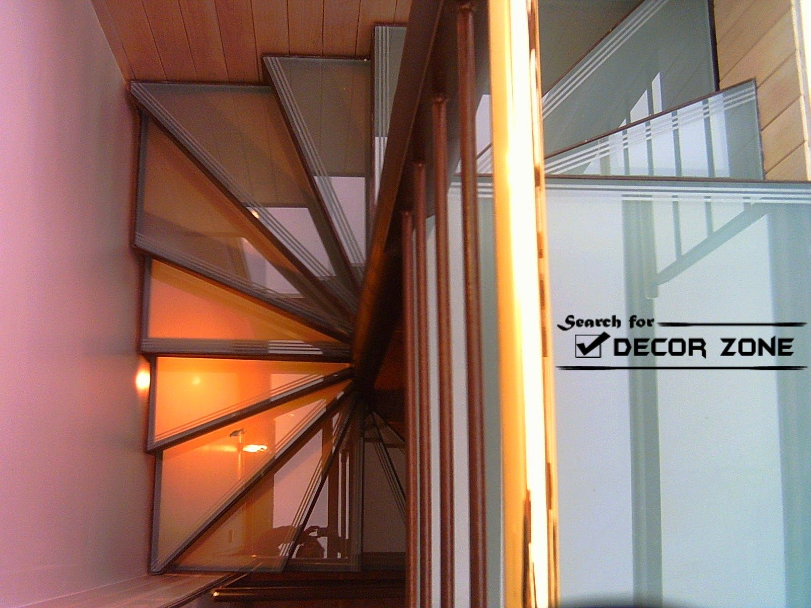 Wooden spiral stairs design with glass staircase panels for Spiral stair design