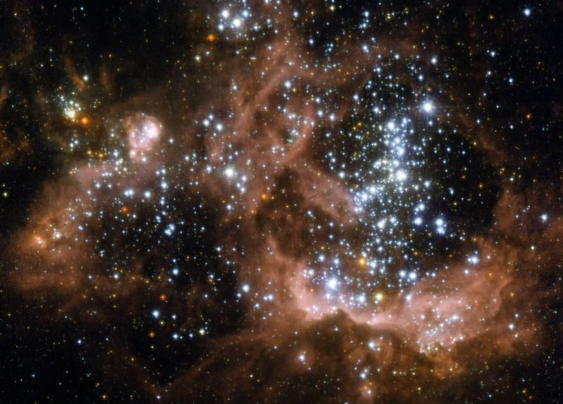 NGC 604, a star forming region in the Triangulum Galaxy, as imaged by the Hubble Space Telescope.