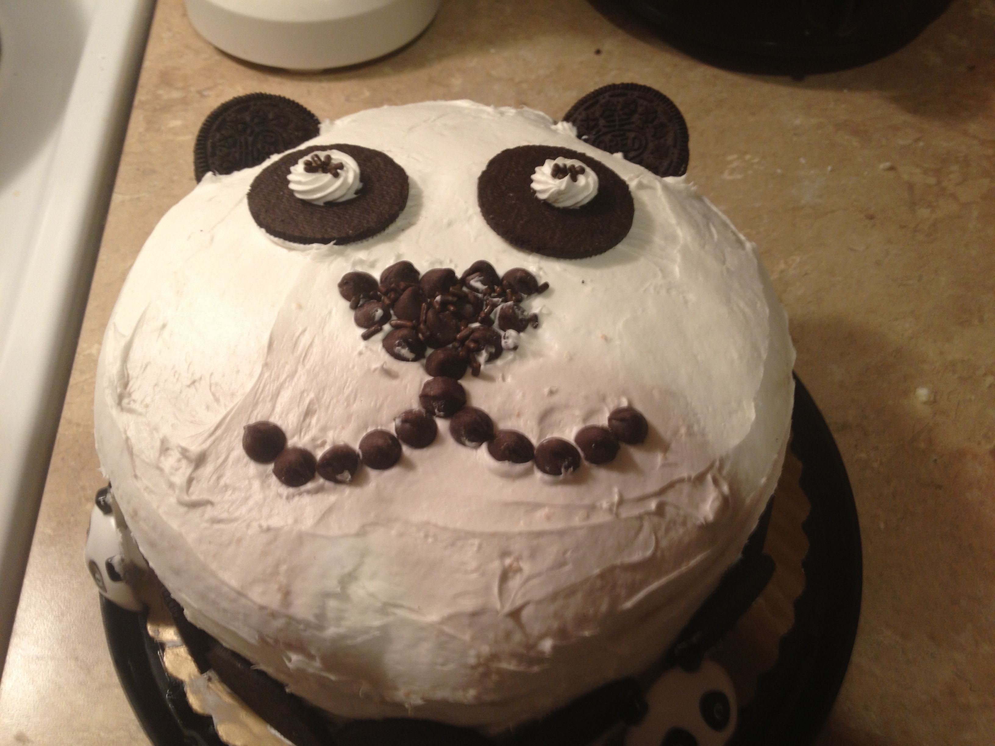Layered cake with Oreo cookies, chocolate sprinkles, and chocolate chips.