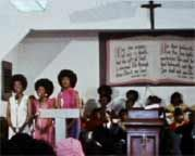 Wattstax- A service taking place in a storefront church.