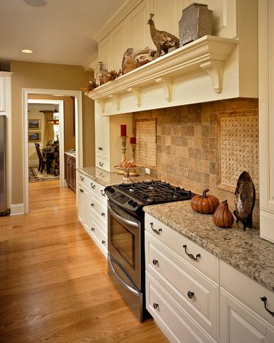 Kitchen Paint Colors With Cream Cabinets: Kitchen With Cream Cabinetry And Neutral Tile Backsplash