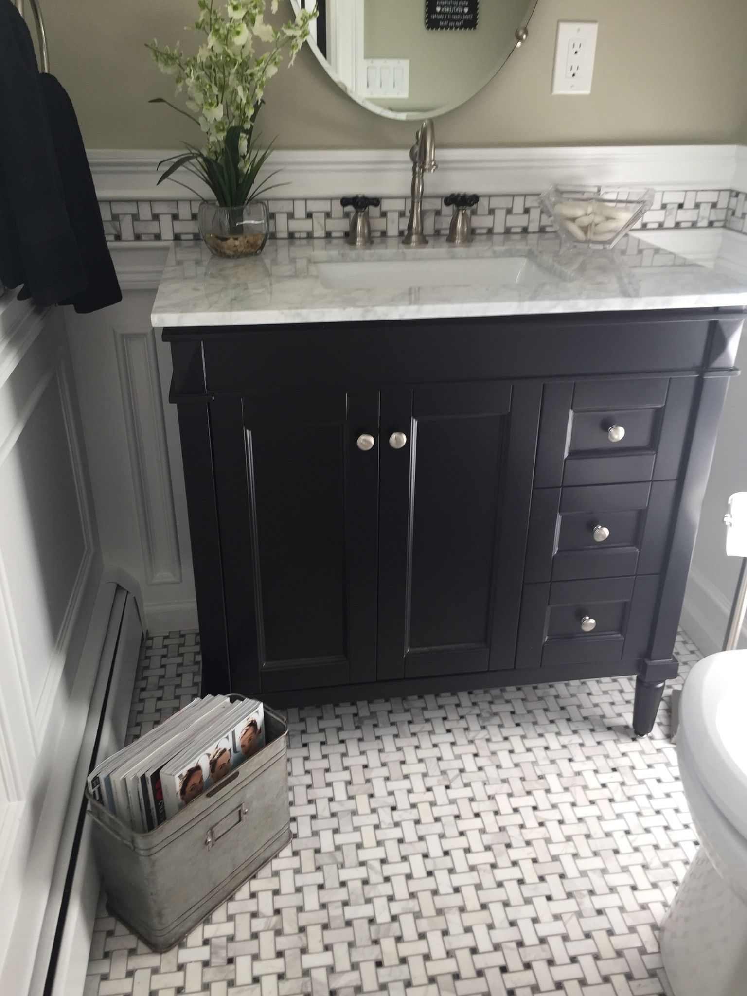 Beautiful Black Vanity With Marble Top And Grey White Marble Flooring Flanked With Tin Magazine Rack Wain White Marble Floor Laundry Design Marble Flooring
