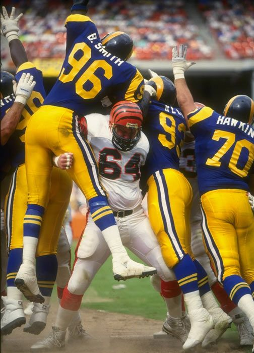 Bengals offensive lineman Bruce Kozerski does double-duty as he blocks Rams defenders Brian Smith and Doug Reed at Anaheim Stadium 1990