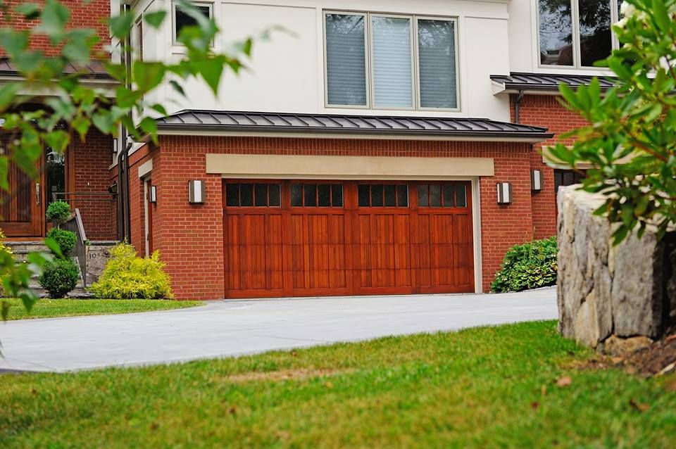 A Sense Of History Underlies Our Wood Garage Doors Making Them Unforgettable Beautifully Crafted From Either Western Red Doors Garage Doors Wood Garage Doors
