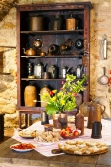 Tuscan Style Kitchen Tables a rustic feel with all the kitchen crockery on display is a great