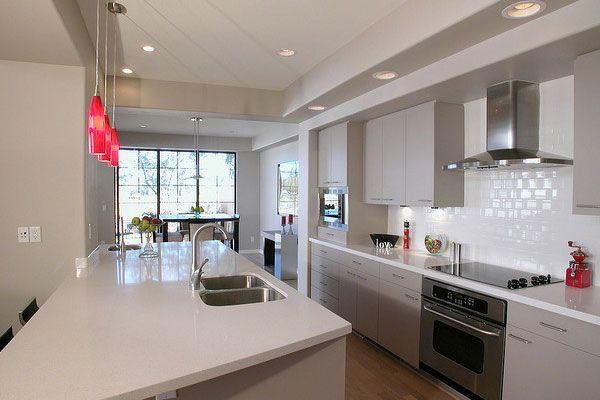 White And Grey Galley Kitchen modern australian- grey and white galley kitchen with timber floor