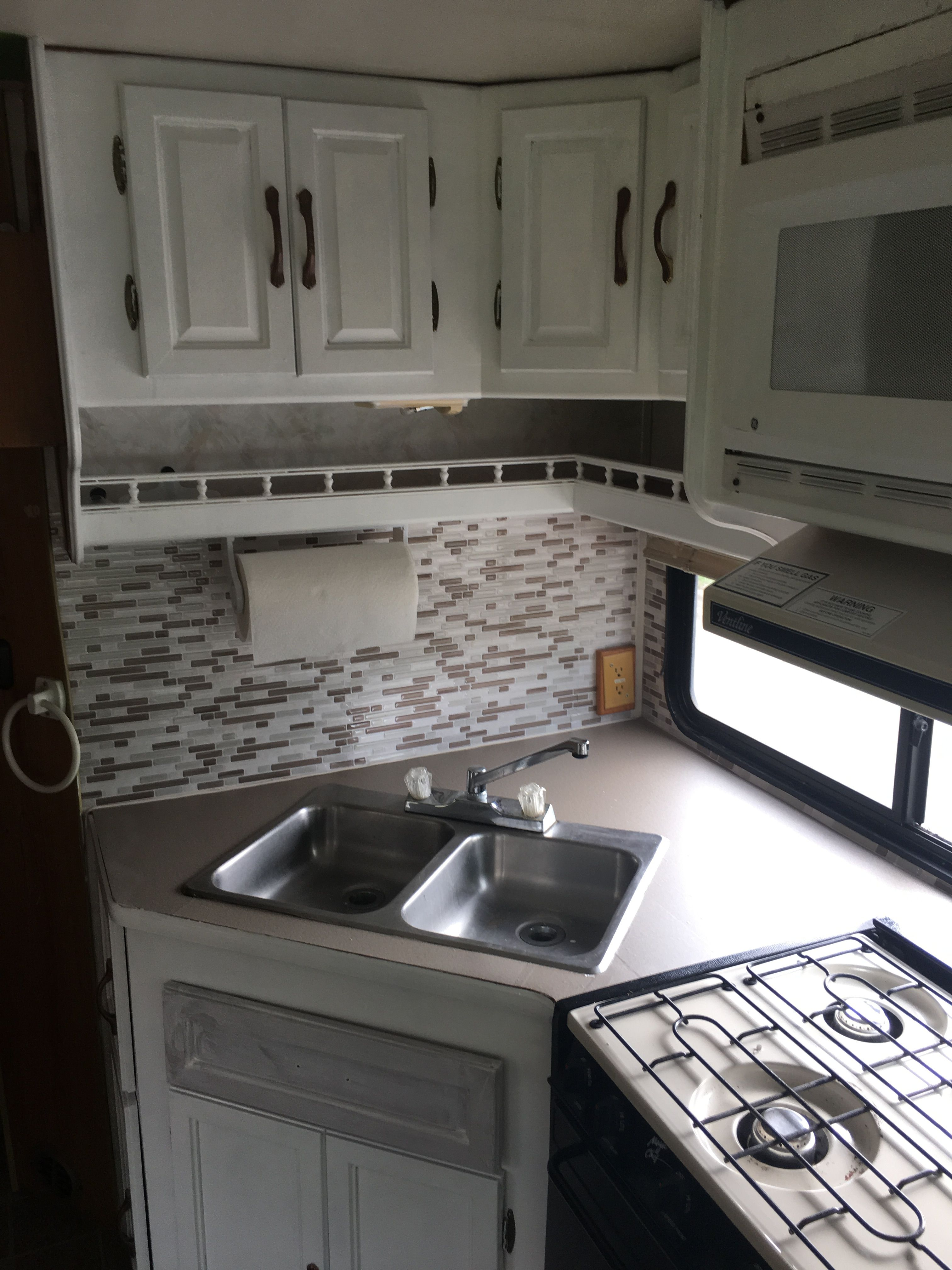 After I added peel and stick backsplash and contact paper to counter