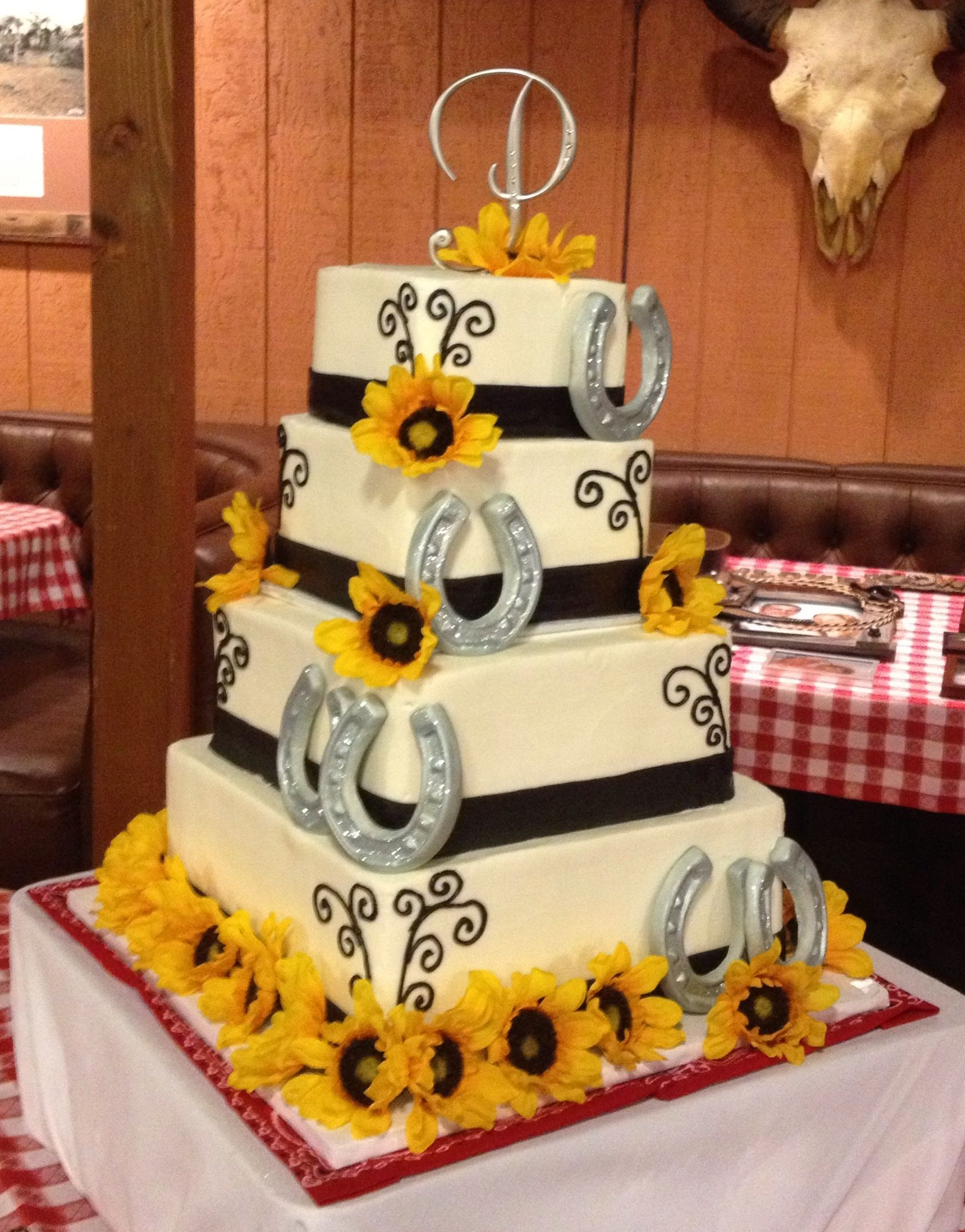 Western wedding cakee the idea but with orange gerber daisies