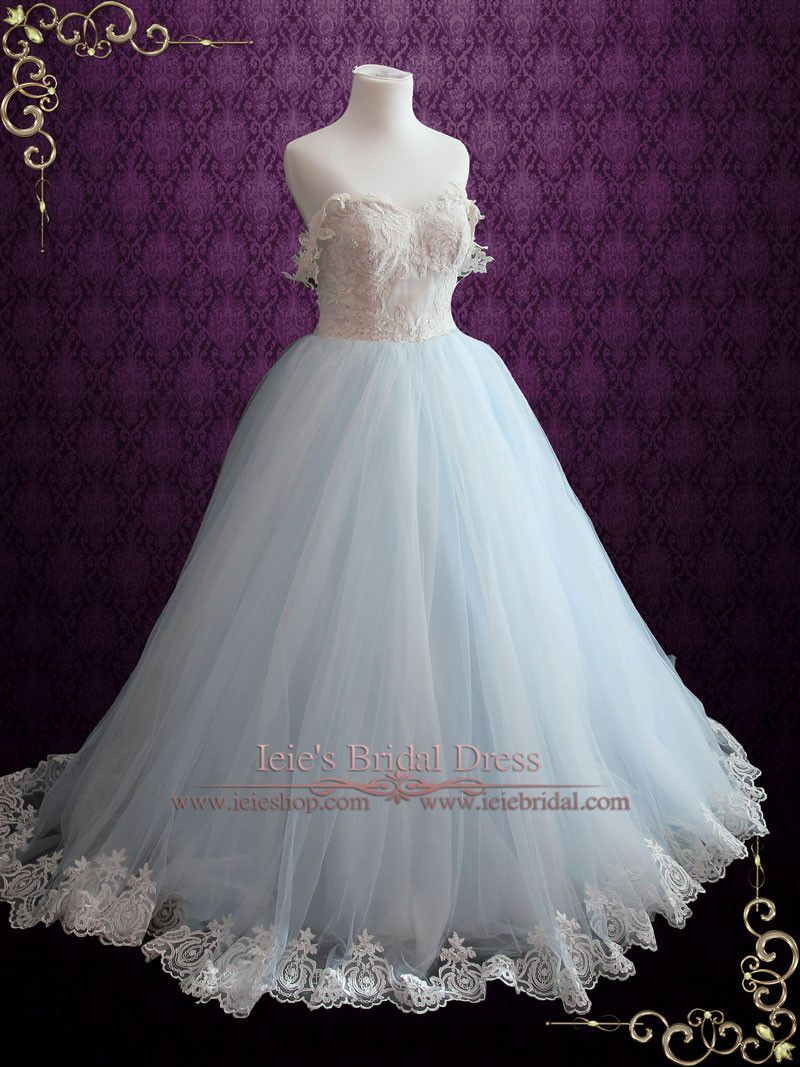 Beautiful Ice Blue Wedding Dress With Lace Bodice Featuring Ball Gown Skirt Layers Of Tulles And A Light Champagne Covered Tulle Accented