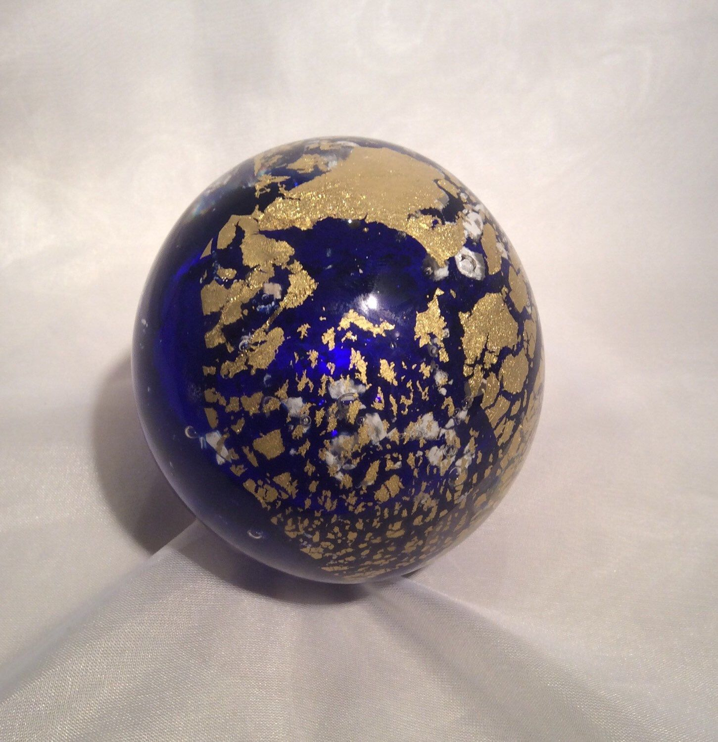 A personal favorite from my Etsy shop https://www.etsy.com/listing/286014339/pet-memorial-glass-art-paperweight-with